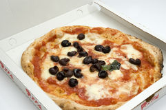 ORIGINAL NEAPOLITAN PIZZA. A juicy handcrafted original neapolitan pizza in a box Stock Photo