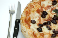 ORIGINAL NEAPOLITAN PIZZA. An original juicy handcrafted neapolitan pizza, ready to eat royalty free stock photography