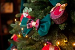 Original new Year decorations on the branches of the Christmas tree Stock Photos