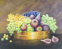 Original oil painting on canvas - Still life with fruit in coppe. R pan on dark brown background. Red apples, green and blue grapes and figs Royalty Free Stock Images