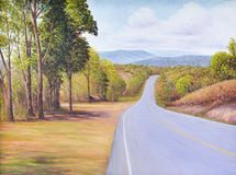 Original oil painting of the road with beautiful landscape. Trees, mountain and cloudy blue sky Stock Photo