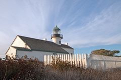 ORIGINAL OLD POINT LOMA LIGHTHOUSE UNDER CIRRUS CLOUD SKIES AT POINT LOMA SAN DIEGO CALIFORNIA USA Stock Photo