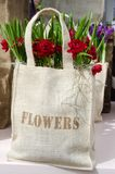 Original package and gift: flowers in the bag Royalty Free Stock Image