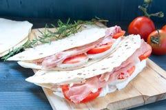 Original Piadina with ham mozzarella and tomato italy Stock Image