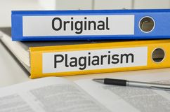 Original and Plagiarism. Folders with the label Original and Plagiarism stock image
