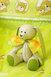 Original plush animal toy in the baby bed Royalty Free Stock Photography