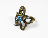 Original ring from dark metall. With several colour stones Royalty Free Stock Images