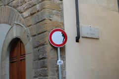 Original road signs in Florence, Italy. Social art of the artist Clet Abraham. Attracts the attention of drivers and tourists. Original road signs in Florence stock photo
