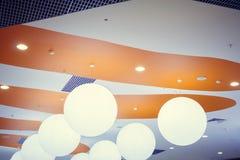 Original round chandeliers, creative lighting of public places. stock photo
