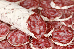 Original Salami. From Italy with Salami slices as background stock image