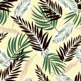 Original seamless pattern with tropical plants on yellow background. Vector design. Jungle print. Printing and textiles. Original seamless pattern with tropical vector illustration
