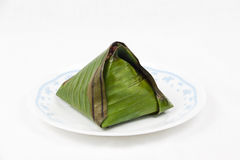 Original single traditional nasi lemak wrapped in banana leaf served on plate. Stock Images