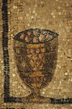 The original still life. Ancient Roman mosaic of a cup of fruit in the patriarchal basilica of Aquilea.  This close-up  is a segment of an immense mosaic floor Royalty Free Stock Photo