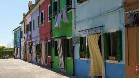 Original style of colorful houses in Burano Island, vivid architecture, Venice. Stock footage stock video