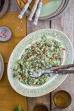 Original tabbouleh Couscous salad. A bowl of Original tabbouleh Couscous salad with mint, herbs, parsley, tomato, cucumber and lemon dressing. Mediterranean and royalty free stock photos