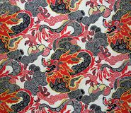 Original textile fabric ornament of the Modern style. Chinese red dragon. Beginning of the XX century: Original textile fabric ornament of the Modern style royalty free stock photography