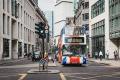 The Original Tour bus painted as Union Jack on a street in the City of London, UK. The Original Tour bus painted as Union Jack on a street in the City of London royalty free stock image