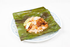 Original traditional and simple nasi lemak in banana leaf Stock Image