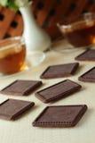 Original- tunn kapten i en choklad med te Arkivbilder