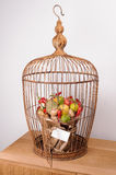 The original unusual edible vegetable and fruit bouquet  with card in bird cage Royalty Free Stock Photos