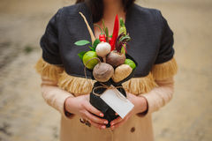 The original unusual edible vegetable and fruit bouquet  with card  in girl hands Royalty Free Stock Image