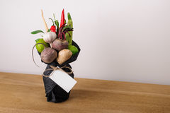 The original unusual edible vegetable and fruit bouquet  with card Stock Photography
