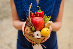 The original unusual edible vegetable and fruit bouquet in girl hands Royalty Free Stock Image