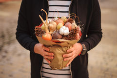 The original unusual edible vegetable and fruit bouquet   in man hands Royalty Free Stock Image