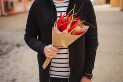 The original unusual edible vegetable and fruit bouquet  man hands Royalty Free Stock Photography
