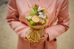 The original unusual edible vegetable and fruit bouquet   in woman hands Royalty Free Stock Image