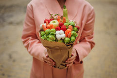 The original unusual edible vegetable and fruit bouquet  in woman hands. The original unusual edible bouquet of vegetables and fruits in woman hands Royalty Free Stock Photography
