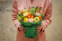 The original unusual edible vegetable and fruit bouquet  in woman hands Stock Photos