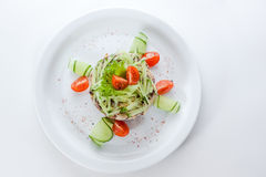 Original vegetarian salad with cucumbers and tomat Stock Image