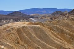 Original view of Zabriskie point with a road in background. In Death Valley National Park, California, USA Stock Images