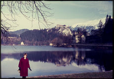 Original vintage colour slide from 1960s, woman standing by lake Royalty Free Stock Image