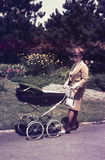 Original vintage  colour slide from 1960s, young woman walking h Stock Photography