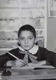Original 1950 vintage photo young boy elementary student. Original photo of the 50's. A italian child is sitting behind a school desk. Elementary school student Stock Photos