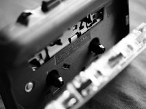 Walkman and cassette in black and white. The original Walkman, released in 1979, was a portable cassette player that changed listening habits by allowing people stock image