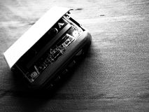 Walkman and cassette in black and white. The original Walkman, released in 1979, was a portable cassette player that changed listening habits by allowing people royalty free stock photography