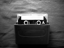 Walkman and cassette in black and white. The original Walkman, released in 1979, was a portable cassette player that changed listening habits by allowing people royalty free stock image