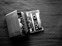 Walkman and cassette in black and white. The original Walkman, released in 1979, was a portable cassette player that changed listening habits by allowing people royalty free stock photo