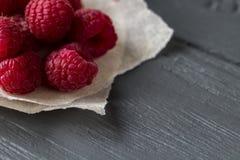 Original wallpaper for your desktop. Fresh raspberry pile on the wooden table. Fresh raspberry pile on the wooden table. Original wallpaper for your desktop Stock Photography