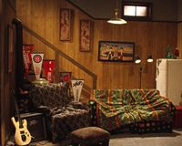 Wayne`s World set at SNL Exhibition in NYC. Original Wayne`s World set on Saturday Night Live. Includes couch, chair, guitar, amp, stairs and fridge. Memorabilia Stock Image