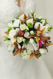 Original wedding bouquet of white roses and greenery Stock Photography