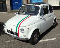 Original white Fiat 500, with tricolore stripes. 1972 build year. Original white Fiat 500 with tricolore stripes. 1972 build year. Location, Motor Mania 2017 Stock Photo