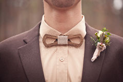 The original wooden bow tie. And boutonniere Royalty Free Stock Photos