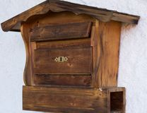 Original wooden mailbox. Wooden mailbox with newspaper roll royalty free stock photography