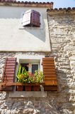 The original wooden shutters on stone wall in old Budva, Montenegro Stock Images