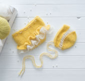 Original yellow hat, pants for newborn, topview Royalty Free Stock Photo