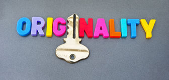 Originality holds the key. Text 'originality' with letter 'i' replaced by a gold key. Progress in business, politics  and academia often depends on originality Royalty Free Stock Photo